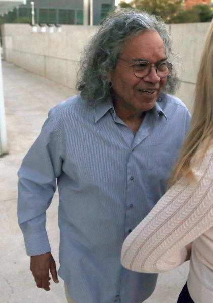 Billionaire founder of Insys Therapeutics John Kapoor leaves U.S. District Court after being arrested earlier Thursday, Oct. 26, 2017, in Phoenix. Kapoor and other defendants in the fraud and racketeering case are accused of offering bribes to doctors to write large numbers of prescriptions for a fentanyl-based pain medication meant only for cancer patients with severe pain. A judge set bail at $1 million for Kapoor, saying he must wear electronic monitoring and surrender his passports. (AP Photo/Ross D. Franklin)