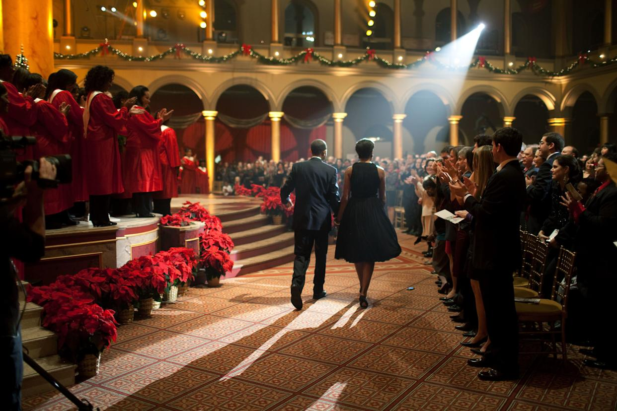 """The Obamas attend the """"Christmas in Washington"""" taping at the National Building Museum in Washington on Dec. 13, 2009."""