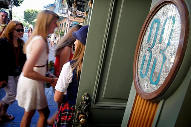 Visitors go into Club 33 on April 18, 2013, at Disneyland in Anaheim, Calif. (Photo: Don Bartletti/Los Angeles Times via Getty Images)