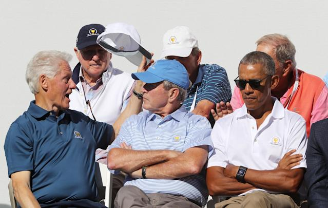 <p>(L-R) Former U.S. Presidents Bill Clinton, George W. Bush and Barack Obama attend the trophy presentation prior to Thursday foursome matches of the Presidents Cup at Liberty National Golf Club on September 28, 2017 in Jersey City, New Jersey. (Photo by Sam Greenwood/Getty Images) </p>