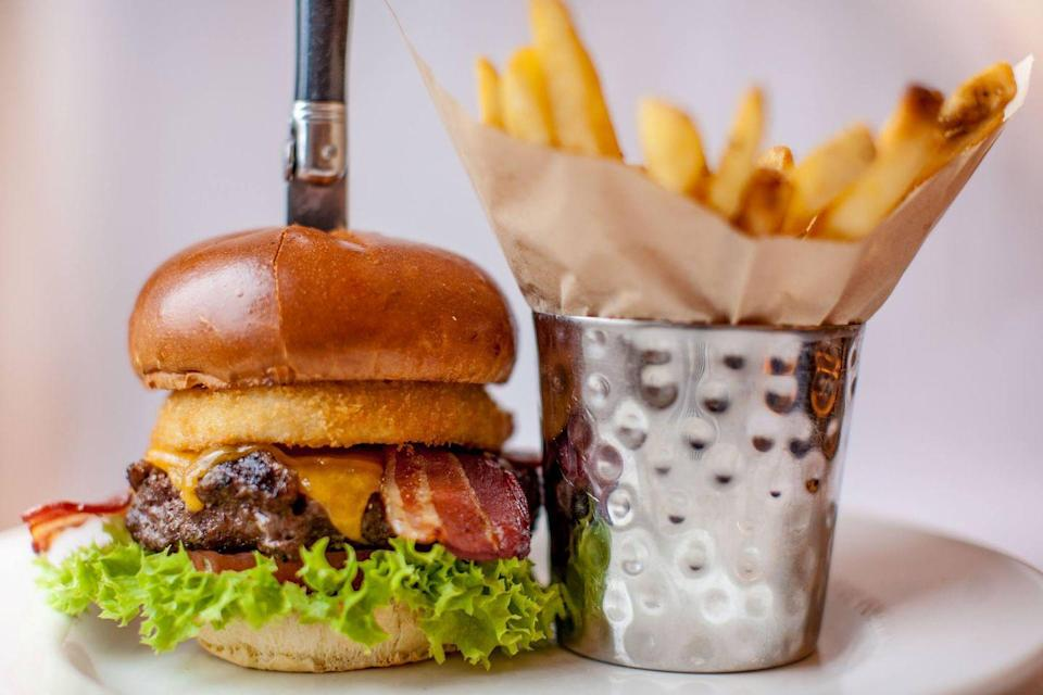 """<p>America's favorite restaurant-slash-rock-and-roll-museum started off with <a href=""""https://www.delish.com/restaurants/a52953/hard-rock-cafe-facts/"""" rel=""""nofollow noopener"""" target=""""_blank"""" data-ylk=""""slk:the founders' burger craving"""" class=""""link rapid-noclick-resp"""">the founders' burger craving</a>, so it's not a far leap that the Hard Rock Cafe's burgers are its calling card. It's one of those burgers that is customers' favorite thing to order. The <a href=""""https://www.hardrockcafe.com/menu.aspx"""" rel=""""nofollow noopener"""" target=""""_blank"""" data-ylk=""""slk:Original Legendary Burger"""" class=""""link rapid-noclick-resp"""">Original Legendary Burger</a> is plain and simple burger flawlessness. It's a half-pound steak burger topped with smoked bacon, cheddar cheese, an onion ring, lettuce, tomato, and signature steak sauce. </p>"""