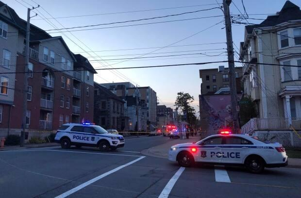 Halifax Regional Police vehicles responded to reports of a shooting in the city's downtown late Friday. (Emma Davie/CBC - image credit)