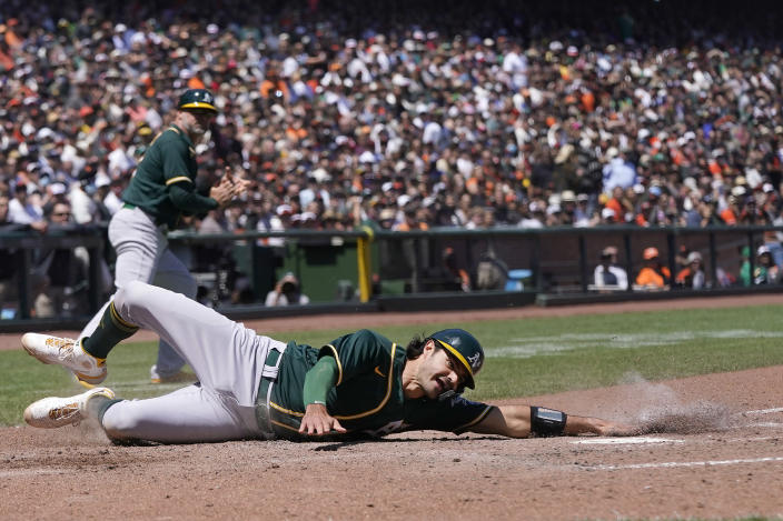 Oakland Athletics' Aramis Garcia slides home to score against the San Francisco Giants during the sixth inning of a baseball game in San Francisco, Sunday, June 27, 2021. (AP Photo/Jeff Chiu)
