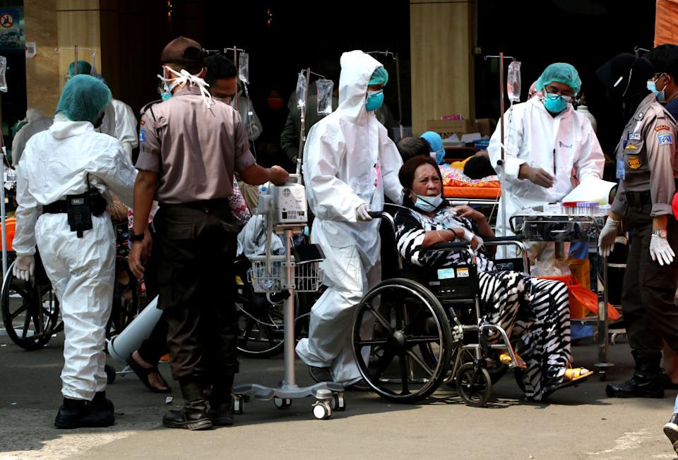 Covid-19 patients crowd the yard and emergency tents at a hospital in West Java last month. Source: Getty