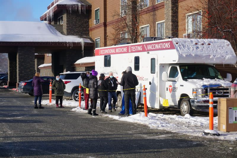 Support workers for the Iditarod Trail Sled Dog Race line up outside the Lakefront Anchorage Hotel, the site of the temporary Anchorage Iditarod headquarters, to be tested for coronavirus (COVID-19), in Anchorage, Alaska