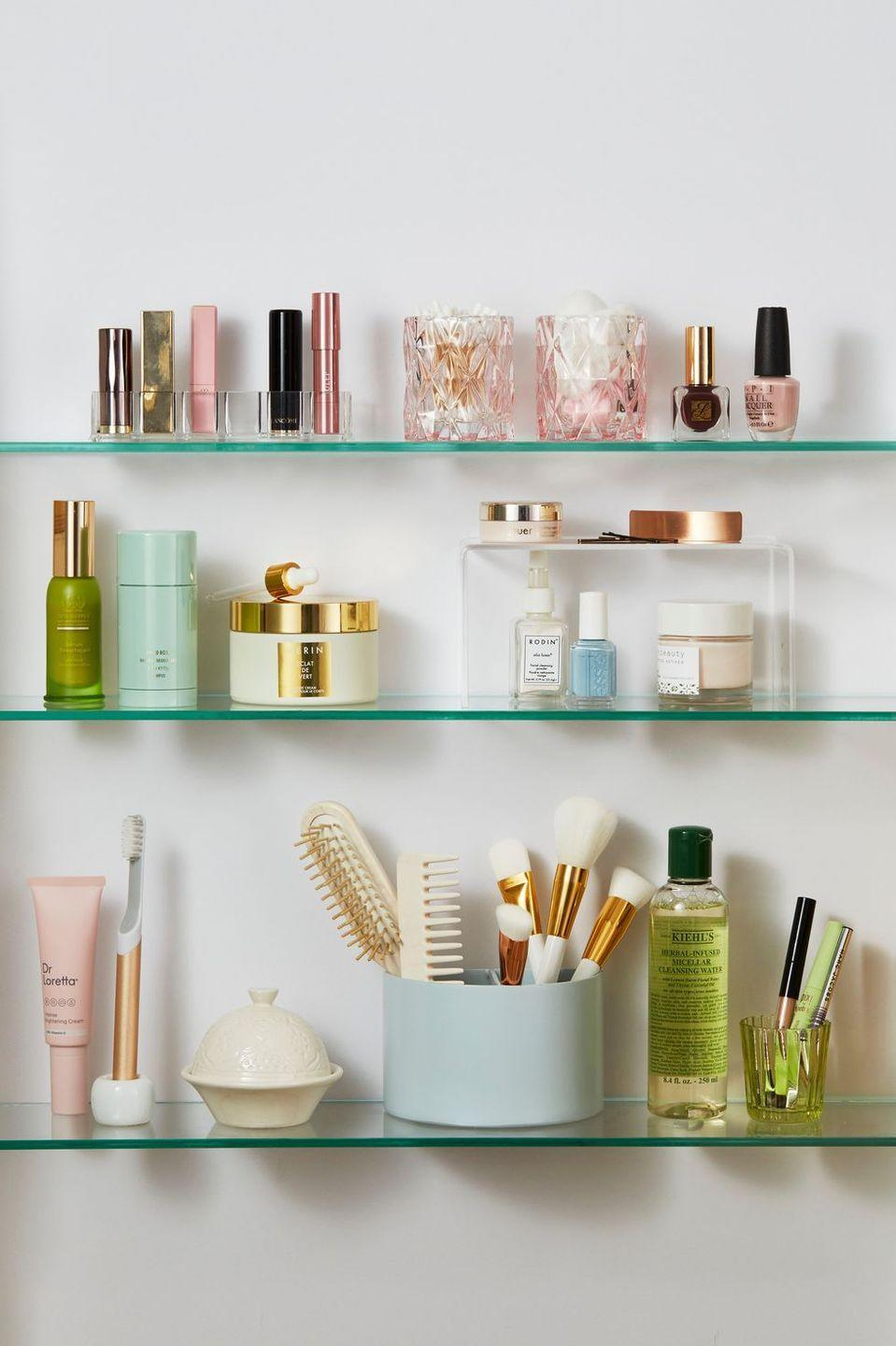 "<p>Maintain orderly bathroom shelves by placing makeup brushes, hair tools, and smaller items in containers and purging any unwanted products. </p><p><strong>RELATED</strong>: <a href=""https://www.goodhousekeeping.com/home/organizing/g25922638/bathroom-shelf-ideas/"" rel=""nofollow noopener"" target=""_blank"" data-ylk=""slk:12 Smart Bathroom Shelf Ideas to Keep Your Toiletries Under Control"" class=""link rapid-noclick-resp"">12 Smart Bathroom Shelf Ideas to Keep Your Toiletries Under Control</a></p>"