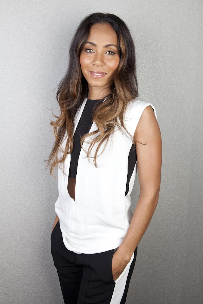 "This April 4, 2013 photo shows actress-filmmaker Jada Pinkett Smith posing for a portrait to promote the documentary, ""Free Angela and All Political Prisoners,"" in New York. The film is about activist Angela Davis. (Photo by Amy Sussman/Invision/AP)"