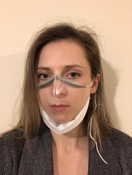 Design and innovation engineer Abi Bush demonstrates the new see-through mask. (Cambridge University Hospitals/ PA)