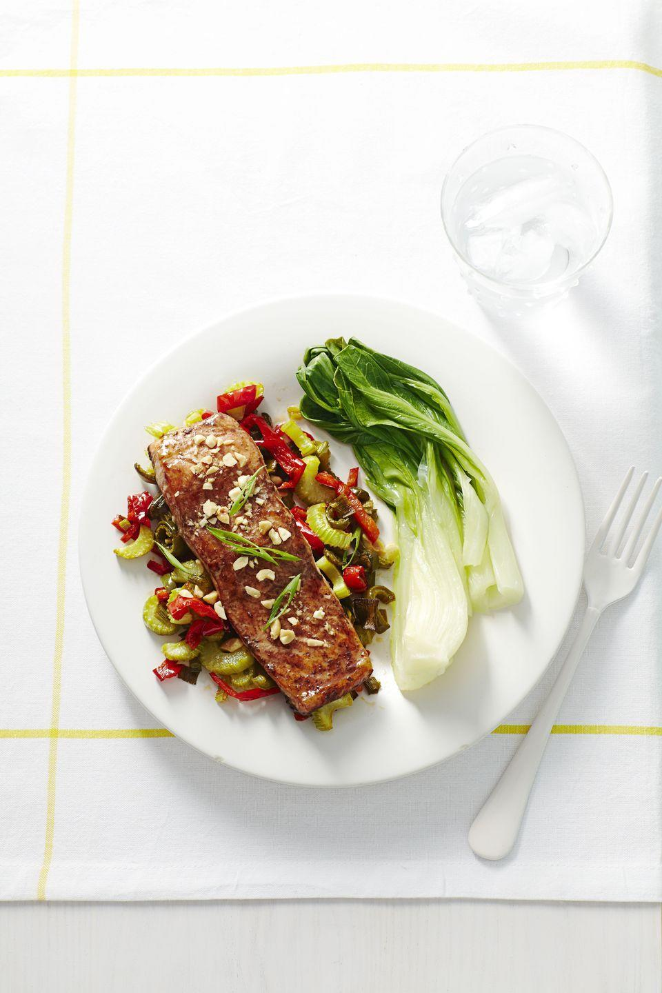 """<p>Ready in under 30 minutes, this tasty dinner fits within the low-carb, high-protein Atkins diet. It also fits into the """"I want food that is delicious <em>and </em>healthy ASAP"""" meal plan. </p><p><em><a href=""""https://www.goodhousekeeping.com/food-recipes/a16349/spicy-soy-glazed-salmon-recipe-ghk0115/"""" rel=""""nofollow noopener"""" target=""""_blank"""" data-ylk=""""slk:Get the recipe for Spicy Soy-Glazed Salmon »"""" class=""""link rapid-noclick-resp"""">Get the recipe for Spicy Soy-Glazed Salmon »</a></em> </p>"""