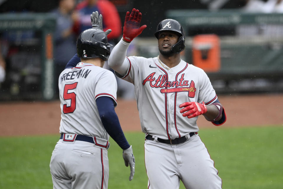 Atlanta Braves' Jorge Soler, right, celebrates his home run with Freddie Freeman (5) during the fourth inning of a baseball game against the Baltimore Orioles, Sunday, Aug. 22, 2021, in Baltimore. (AP Photo/Nick Wass)