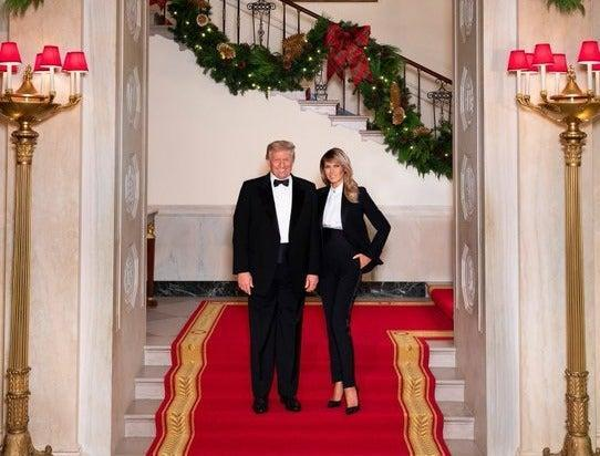 <p>Donald and Melania Trump wear matching tuxedos in their final Christmas card from the White House</p> (Official White House Photo by Andrea Hanks)