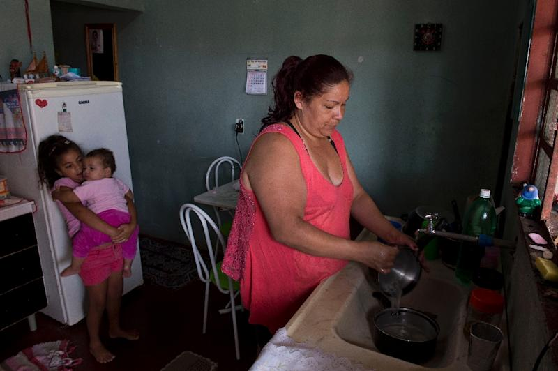 Monica de Oliveira and her husband had a combined monthly salary of about $500, but now both have been laid off and one by one their little luxuries have disappeared (AFP Photo/Nelson Almeida)