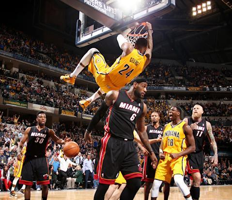 INDIANAPOLIS, IN - MARCH 26: Paul George #24 of the Indiana Pacers dunks over LeBron James #6 of the Miami Heat during a game on March 26, 2014 at Bankers Life Fieldhouse in Indianapolis, IN. (Photo by Nathaniel S. Butler/NBAE via Getty Images)