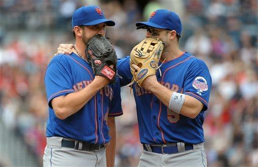 New York Mets starting pitcher Jonathon Niese, left, and third baseman David Wright (5) talk after Niese loaded the bases against the Atlanta Braves during the third inning of a baseball game at Turner Field, Sunday, May 5, 2013, in Atlanta. (AP Photo/David Tulis)