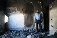 Mohammed Elfarawi stands in the severely damaged room that belonged to his son Adam who was killed when an airstrike targeted the apartment below prior to a cease-fire that halted an 11-day war between Gaza's Hamas rulers and Israel, Thursday, May 27, 2021, in Gaza City. (AP Photo/John Minchillo)