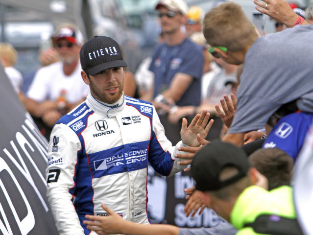 FILE - In this July 30, 2017, file photo, Ed Jones greets fans during driver introductions for the IndyCar auto race at Mid-Ohio Sports Car Course in Lexington, Ohio. Its possible more than 20 percent of this years Indianapolis 500 starters could be, like Zach Veach, younger than 25. The class is rich in diversity and talent. Jones, the 23-year-old from Dubai who was last years rookie of the year, drives for powerhouse team Chip Ganassi Racing. (AP Photo/Tom E. Puskar, File)