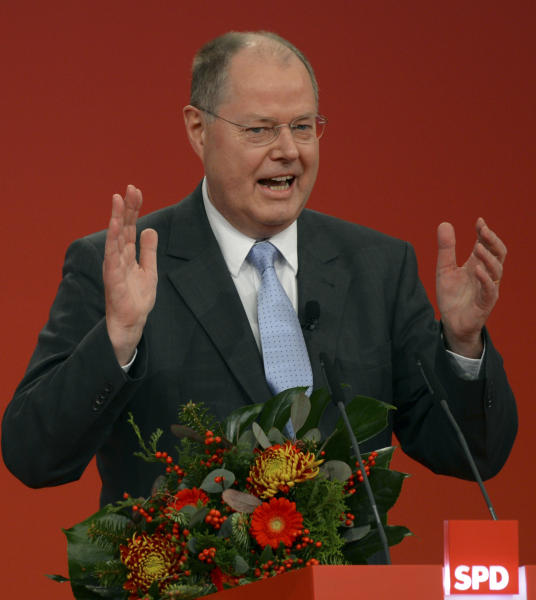 German Chancellor Angela Merkel's challenger for the next elections Peer Steinbrueck of the SPD delivers a speech during an extraordinary party convention of the German Social Democrats, SPD, in Hannover, northern Germany, Sunday, Dec. 9, 2012. The center-left Social Democrats held a special party convention to elect former Finance Minister Steinbrueck officially as their candidate to take on Merkel when Germans elect a new Parliament next fall. (AP Photo/dapd, David Hecker)