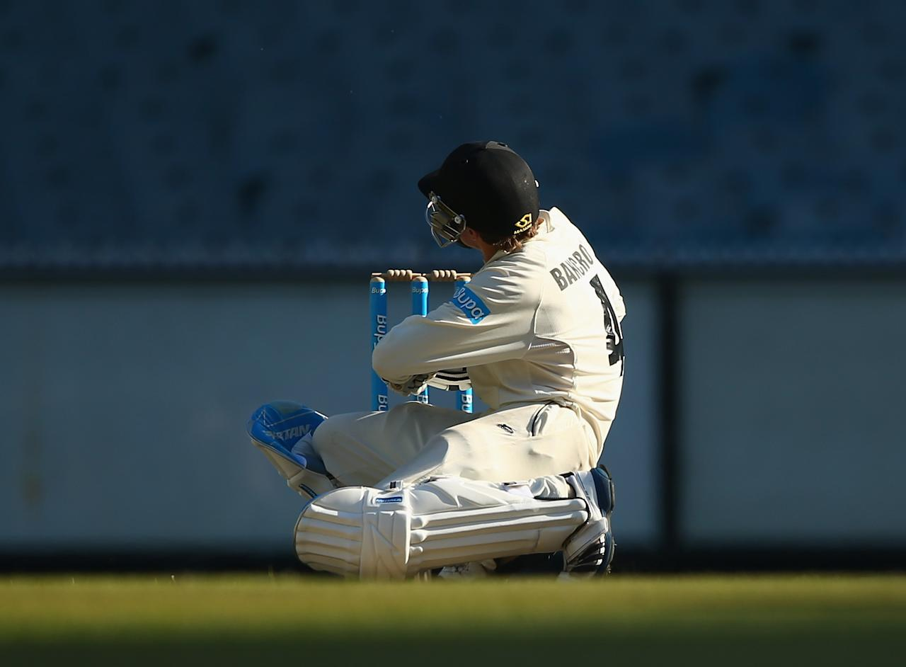 MELBOURNE, AUSTRALIA - NOVEMBER 01: Cameron Bancroft of the Warriors is hit on the helmet by a Peter Siddle bouncer during day three of the Sheffield Shield match between the Victoria Bushrangers and the Western Australia Warriors at Melbourne Cricket Ground on November 1, 2013 in Melbourne, Australia.  (Photo by Robert Cianflone/Getty Images)