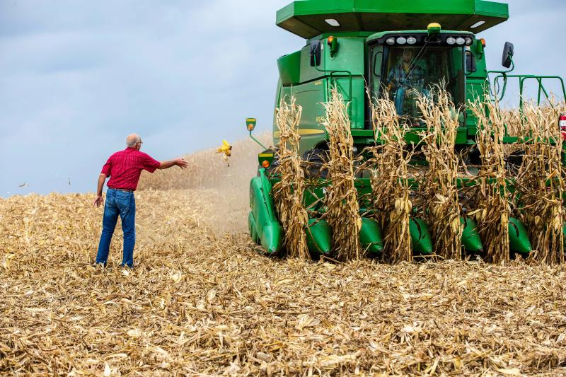 Farmer Bill Sorg (L) works his fields in Hastings, Minnesota. (Photo credit should read KEREM YUCEL/AFP via Getty Images)