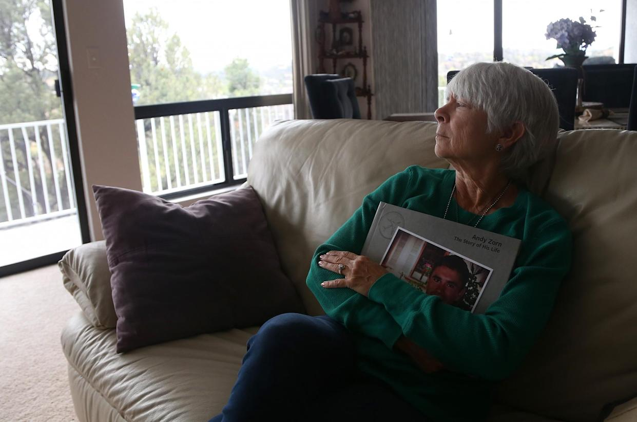 Sally Schindel holds a book of her son's life story at her home in Prescott, Ariz., on April 4, 2017. (Photo: Patrick Breen for Yahoo News)