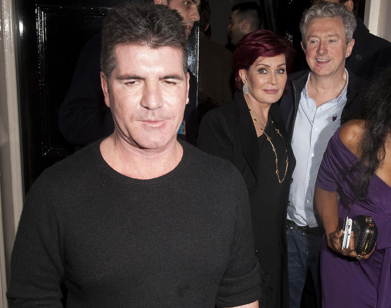 LONDON, UNITED KINGDOM - FEBRUARY 15: Simon Cowell, Sharon Osbourne and Louis Walsh sighting on February 15, 2013 in London, England. (Photo by Niki Nikolova/FilmMagic)