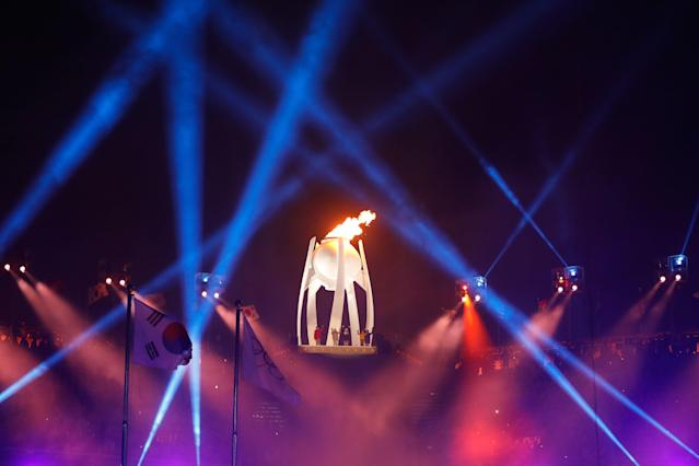 <p>The Olympic Flame burns during the opening ceremony of the Pyeongchang 2018 Winter Olympic Games at the Pyeongchang Stadium on February 9, 2018. / AFP PHOTO / Odd ANDERSEN </p>