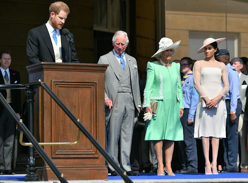 Prince Harry makes a speech for P{rince Charles' 70th birthday garden party Camilla, Prince Charles and Meghan Markle watch on