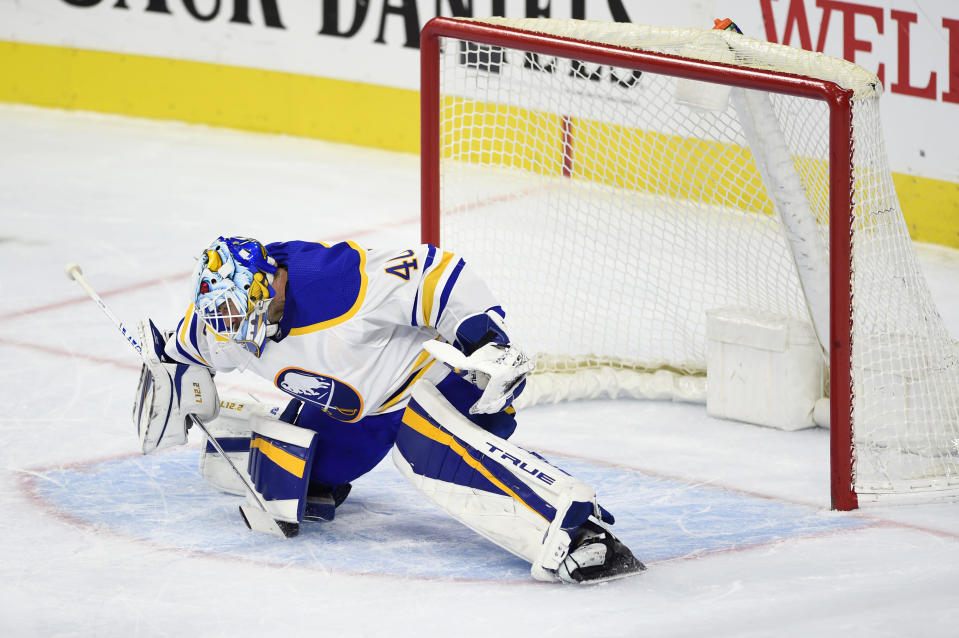 Buffalo Sabres goaltender Carter Hutton is unable to make a save on a goal scored by Philadelphia Flyers' Travis Konecny during the second period of an NHL hockey game, Tuesday, Jan. 19, 2021, in Philadelphia. (AP Photo/Derik Hamilton)