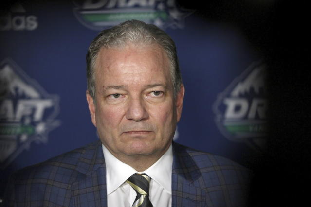 New Jersey Devils general manager Ray Shero speaks to media during the second day of the NHL hockey draft in Vancouver, British Columbia, Saturday, June 22, 2019. (Chad Hipolito/The Canadian Press via AP)