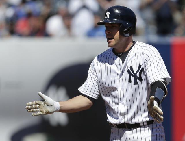 New York Yankees' Austin Romine reacts after hitting a two-run double during the second inning of the baseball game against the Toronto Blue Jays at Yankee Stadium, Sunday, April 22, 2018 in New York. (AP Photo/Seth Wenig)