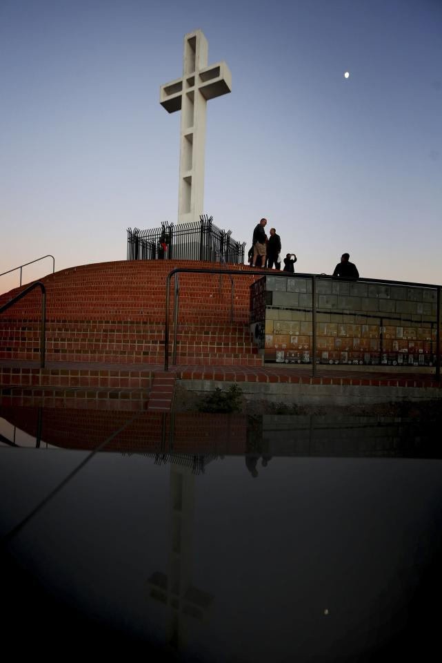 A massive cross sits atop the Mt. Soledad War Memorial in La Jolla, California on December 12, 2013. A federal judge has ruled that the cross is an unconstitutional religious display on government land and must come down within 90 days. The decision could result in the case being sent back to the U.S. Supreme Court. REUTERS/Sandy Huffaker (UNITED STATES - Tags: SOCIETY RELIGION POLITICS)