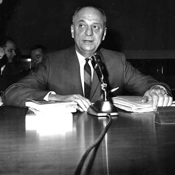 FILE - In this April 9, 1965 file photo, Luther Terry, surgeon general of the U.S., testifies in Washington before the House Commerce Committee on proposed labeling of cigarette packages. On Jan. 11, 1964, Terry released an emphatic and authoritative report that said smoking causes illness and death - and the government should do something about it. (AP Photo)