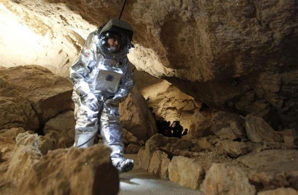 Physicist Daniel Schildhammer wears the Aouda.X spacesuit simulator during a field test of Oesterreichisches Weltraum Forum (Austrian space forum) inside the Eisriesenhoehle (giant ice cave) at Dachstein mountain near the village of Obertraun April 28, 2012. The Aouda.X is a spacesuit simulator for manned missions to Mars, which is being developed under the Mars Analog Research Program PolAres and allows to simulate environmental conditions, a real space suit would be faced on Mars.