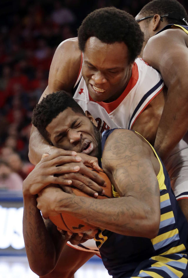 Marquette's Jamil Wilson, bottom, and St. John's God'sgift Achiuwa fight for the ball during the first half of an NCAA basketball game at Madison Square Garden, Saturday, Feb. 1, 2014, in New York. (AP Photo/Seth Wenig)