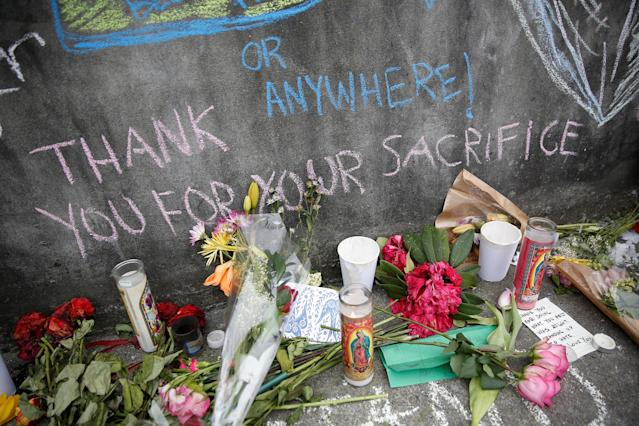 <p>A chalk message is seen at a makeshift memorial for two men who were killed on a commuter train while trying to stop another man from harassing two young women who appeared to be Muslim, in Portland, Ore., May 29, 2017. (Terray Sylvester/Reuters) </p>