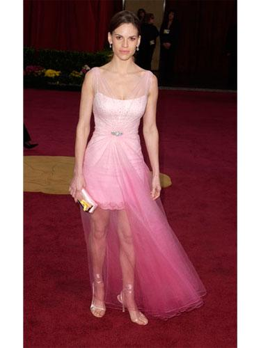 "Worst Dressed: Hilary Swank, 2003-<br />It looks like Hilary thought her pale pink mini dress wasn't up to the occasion, so she looked around until â€"" aha! â€"" she found a piece of hot pink gauze to wrap around herself. The Jimmy Choos are pretty sexy, though. <br> <b>Related: <a rel=""nofollow"" href=""http://www.cosmopolitan.com/celebrity/shoes/sexy-stiletto-high-heels?link=rel&dom=yah_life&src=syn&con=blog_cosmo&mag=cos"">The 20 Heels That Turn Him On</a></b>"