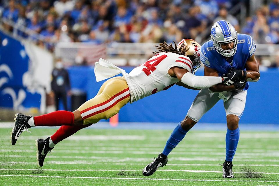 San Francisco 49ers linebacker Fred Warner tackles Detroit Lions wide receiver Tyrell Williams during the first half at Ford Field in Detroit on Sunday, Sept. 12, 2021.