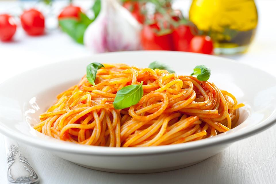 "<p>Is there anything more classic than <a href=""https://www.thedailymeal.com/eat/best-pasta-dish-every-state-slideshow?referrer=yahoo&category=beauty_food&include_utm=1&utm_medium=referral&utm_source=yahoo&utm_campaign=feed"" rel=""nofollow noopener"" target=""_blank"" data-ylk=""slk:spaghetti"" class=""link rapid-noclick-resp"">spaghetti</a> tossed in tomato sauce? And when you take the time to make your own homemade marinara, it's a different experience altogether. The key is using perfectly ripe tomatoes, high-quality extra virgin olive oil, fresh basil leaves and fresh cloves of garlic. The garlic- and basil-infused olive oil in this recipe gives the tomato sauce a rich, authentic flavor. It's a homemade meal you'll want to make over and over again. </p> <p><a href=""https://www.thedailymeal.com/recipes/scarpettas-spaghetti-tomato-sauce-recipe?referrer=yahoo&category=beauty_food&include_utm=1&utm_medium=referral&utm_source=yahoo&utm_campaign=feed"" rel=""nofollow noopener"" target=""_blank"" data-ylk=""slk:For the Spaghetti and Tomato Sauce recipe, click here."" class=""link rapid-noclick-resp"">For the Spaghetti and Tomato Sauce recipe, click here.</a></p>"