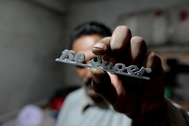 <p>An emblem for a scooter is shown, in the parts store of a Vespa restoration and repair workshop in Islamabad, Pakistan Feb. 27, 2018. (Photo: Caren Firouz/Reuters) </p>