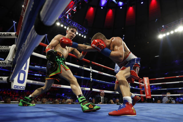 Ireland's Michael Conlan, left, dodges the punch of Russia's Vladimir Nikitin during the eighth round of a WBO intercontinental featherweight boxing match, Saturday, Dec. 14, 2019, in New York. (AP Photo/Michael Owens)