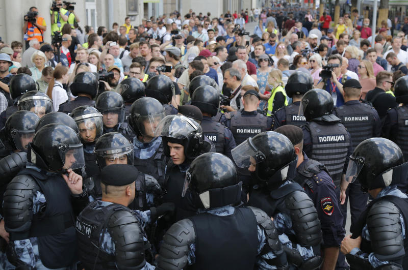 Police block a street prior to an unsanctioned rally in the center of Moscow, Russia, Saturday, July 27, 2019. Police have begun arresting people outside the Moscow mayor's office ahead of a planned protest. OVD-Info, an organization that monitors political arrests, said about 50 people had been detained by 1:30 p.m. Saturday, a half-hour before the protest against the exclusion of opposition figures from the ballot for city council elections was to start. (AP Photo/Alexander Zemlianichenko)
