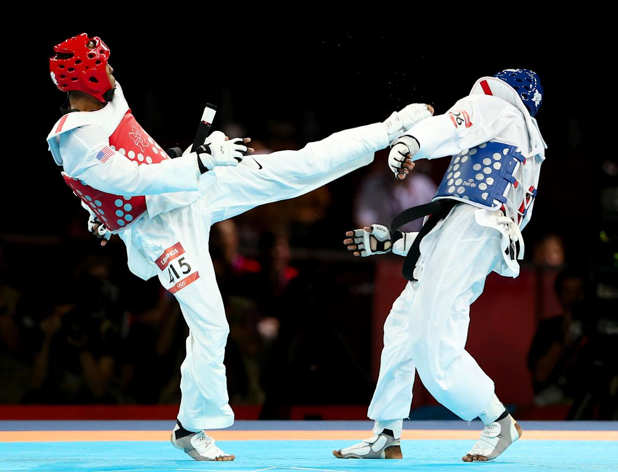 LONDON, ENGLAND - AUGUST 09:  Terrence Jennings (L) of the United States delivers a final blow against Diogo Silva (R) of Brazil during the Men's-68kg Taekwondo bronze medal finals on Day 13 of the London 2012 Olympic Games at ExCeL on August 9, 2012 in London, England.  (Photo by Scott Heavey/Getty Images)