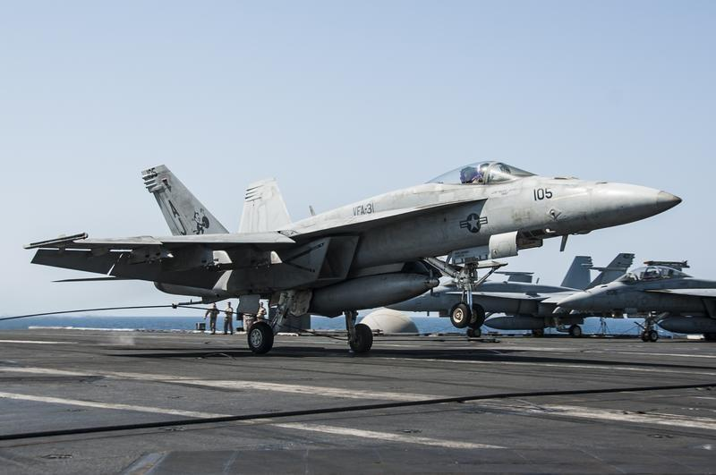 U.S. Navy handout shows F/A-18F Super Hornet attached to the Tomcatters of Strike Fighter Squadron 31 landing aboard the aircraft carrier USS George H.W. Bush after conducting strike missions against Islamic State targets, in the Gulf
