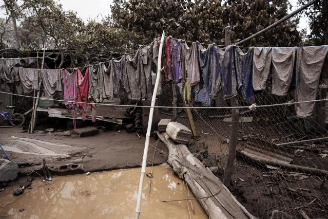 "<p>Apparel hung on a clothesline are covered in volcanic ash outside a home in the disaster zone near the Volcan de Fuego, or ""Volcano of Fire, in the El Rodeo hamlet of Escuintla, Guatemala, Wednesday, June 6, 2018. (Photo: Rodrigo Abd/AP) </p>"