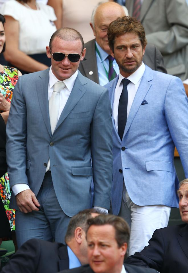 LONDON, ENGLAND - JULY 07: Gerard Butler and Wayne Rooney attend the Gentlemen's Singles Final match between Andy Murray of Great Britain and Novak Djokovic of Serbia on day thirteen of the Wimbledon Lawn Tennis Championships at the All England Lawn Tennis and Croquet Club on July 7, 2013 in London, England. (Photo by Clive Brunskill/Getty Images)