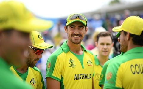 Mitchell Starc of Australia(C) looks on during the Group Stage match  - Credit: getty images