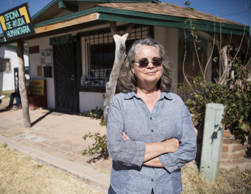 Leesa Jacobson stands outside the Arivaca Humanitarian Aid Office in Arivaca, Arizona.