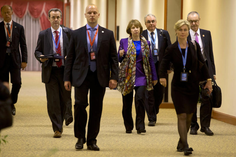 """European Union Foreign Affairs chief Catherine Ashton, fourth from right, walks to a """"Friends of the Lower Mekong Initiative Ministerial"""" meeting after skipping the opening photo-op during the ASEAN security conference in Bandar Seri Begawan, Brunei on Monday July 1, 2013. Ashton raised the issue of allegations that the U.S. bugged EU offices with U.S. Secretary of State John Kerry during a meeting on the sidelines of the conference. Kerry says he doesn't know all the particulars about the allegations, but says many nations engaged in international affairs undertake lots of different kinds of activities to protect their national interests.(AP Photo/Jacquelyn Martin, Pool)"""