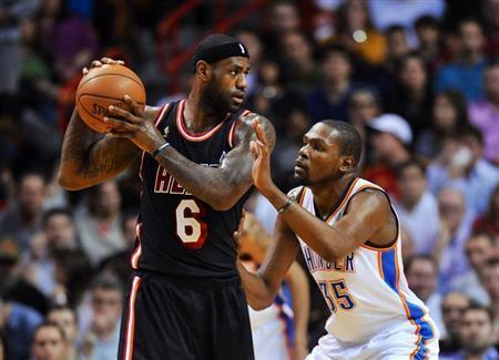 Jan 29, 2014; Miami, FL, USA; Miami Heat small forward LeBron James (6) is pressured by Oklahoma City Thunder small forward Kevin Durant (35) during the first half at American Airlines Arena. Steve Mitchell-USA TODAY Sports - RTX180HC