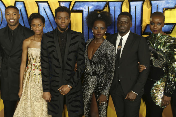 """FILE - In this Feb. 8, 2018 file photo, actors Michael B. Jordan, Leitia Wright, Chadwick Boseman, Lupita Nyong'o, Daniel Kaluuya and Danai Gurira pose for photographers upon arrival at the premiere of the film """"Black Panther"""" in London. Boseman, who played Black icons Jackie Robinson and James Brown before finding fame as the regal Black Panther in the Marvel cinematic universe, has died of cancer. His representative says Boseman died Friday, Aug. 28, 2020 in Los Angeles after a four-year battle with colon cancer. He was 43. (Photo by Joel C Ryan/Invision/AP, File)"""